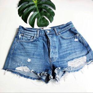 Reformation high rise distressed denim jean shorts